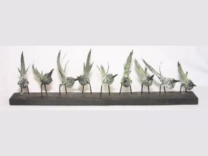 Sculpture of 9 Bee-eaters by James R. Pyne.